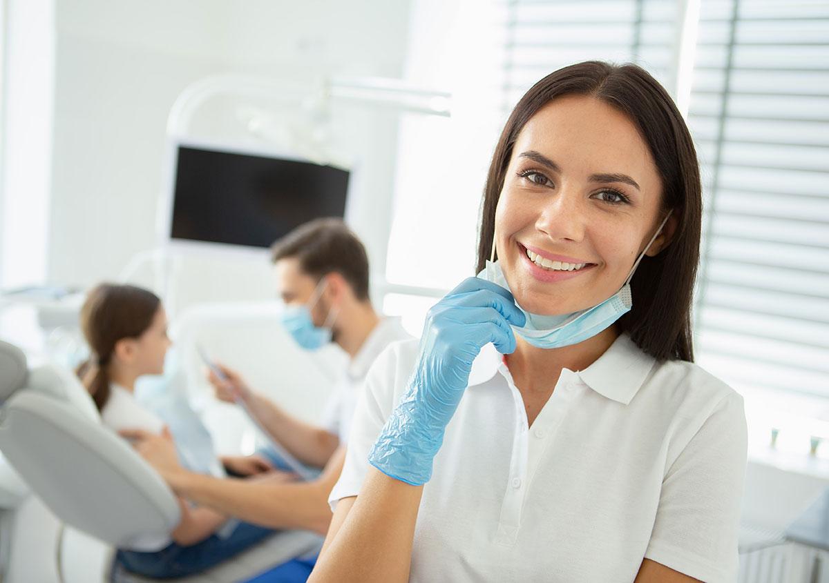 Dentist smiling at the dental