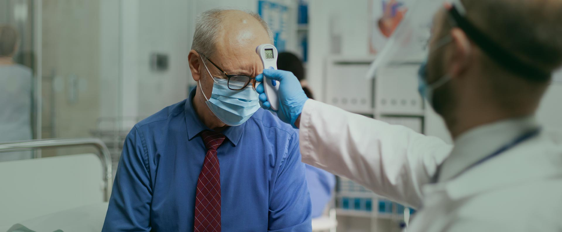 Doctor checking patients body temperature at the dental