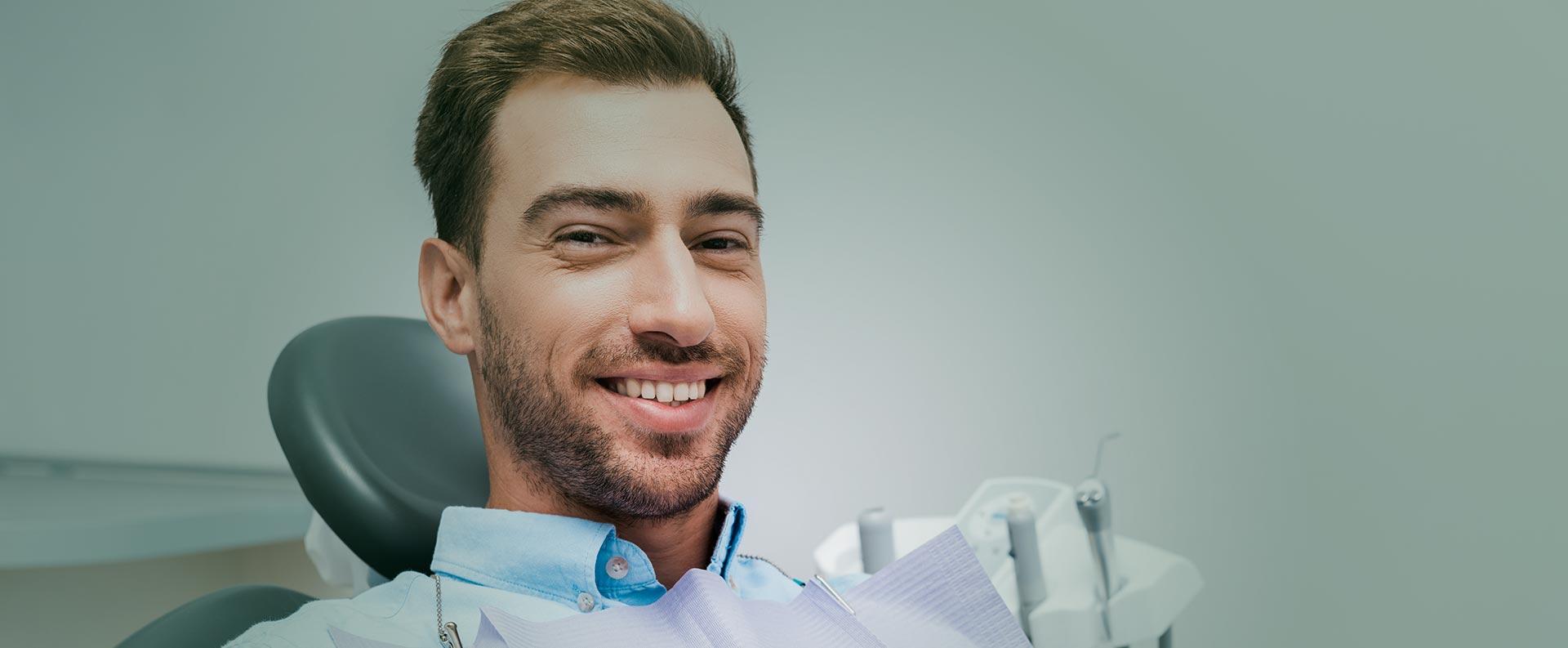 Man smiling at the dental clinic
